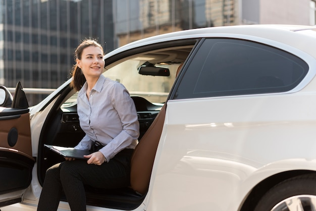 Brunette businesswoman with car
