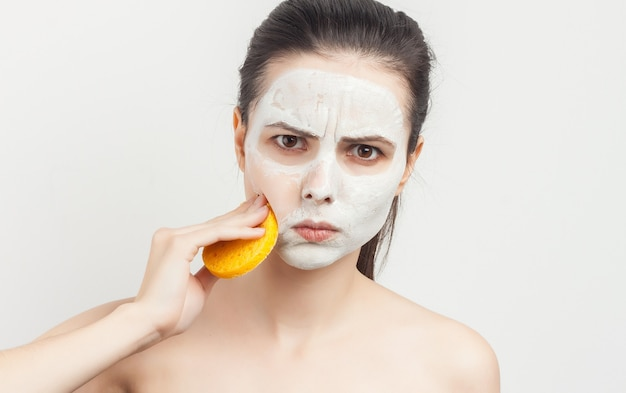 Brunette cream face mask bare shoulders isolated