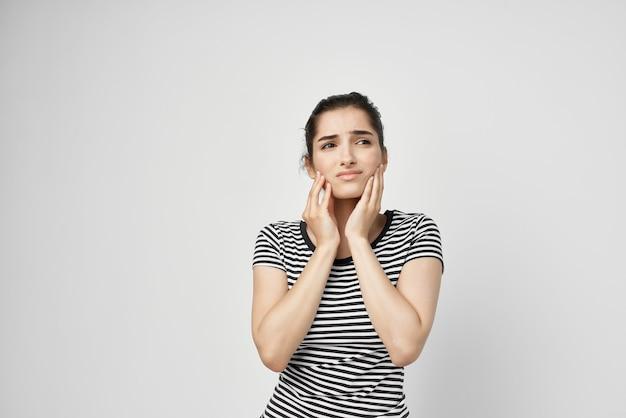 Brunette dentistry health problems discomfort light background