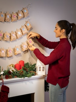 Brunette female arranging ornaments