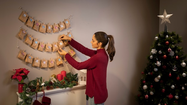 Brunette girl arranging christmas ornaments