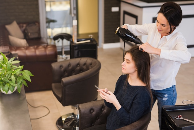 Brunette girl getting her hair done