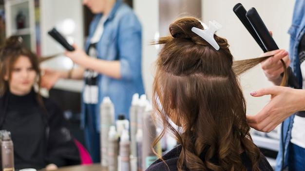 Brunette girl getting her hair done