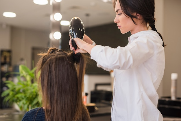Brunette girl getting her hair dried
