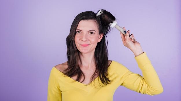 Brunette girl posing with brush