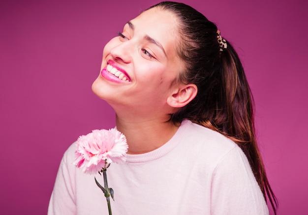 Brunette girl posing with carnation