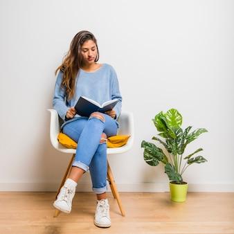 Brunette girl sitting reading a book