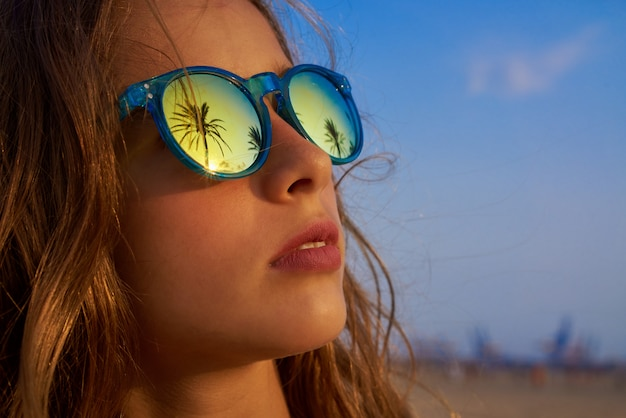 Brunette girl sunglasses with palm tree