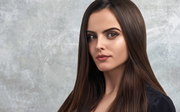 Brunette girl with perfect healthy hair and skin with natural make up with copy space