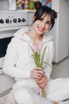 Brunette girl with a pink flowers