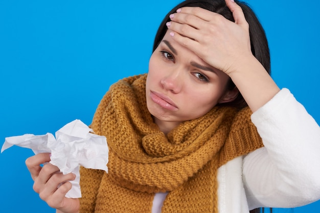 Brunette girl with runny nose and cough isolated.