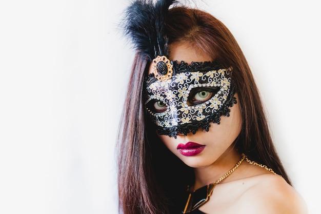 Brunette girl with a white venetian mask