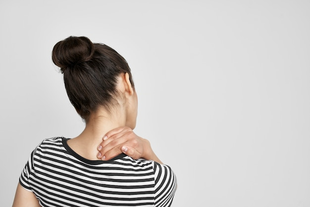 Brunette headache painful syndrome discomfort light background