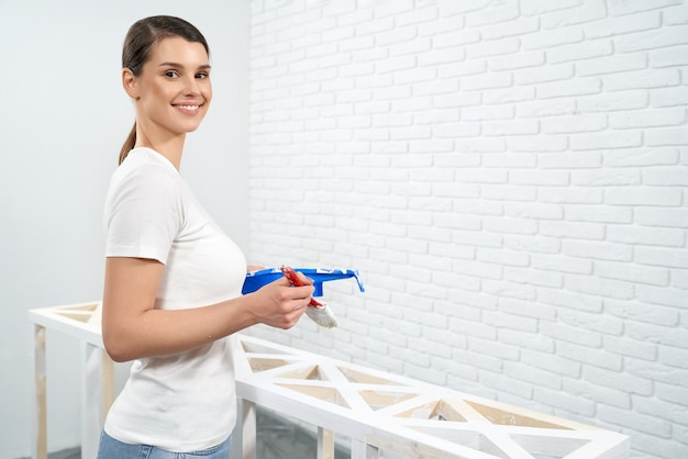 Brunette holding paint and brushes for drawing