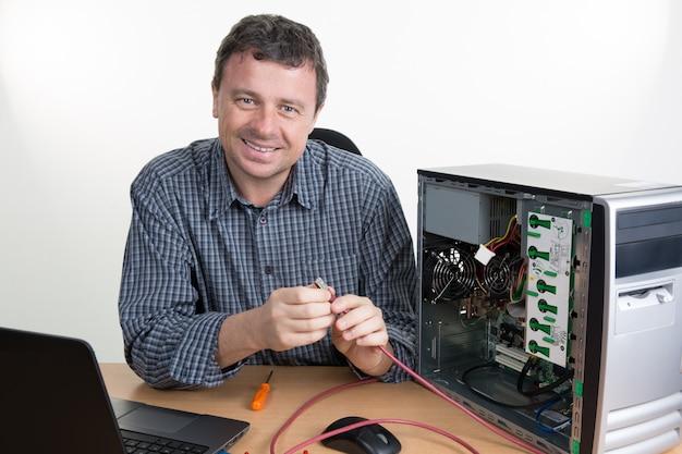 Brunette it specialist installing ram memory at work