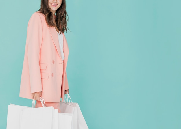 Brunette lady  in pink suit with shopping nets