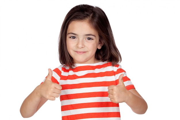 Brunette little girl saying ok isolated on a over white background