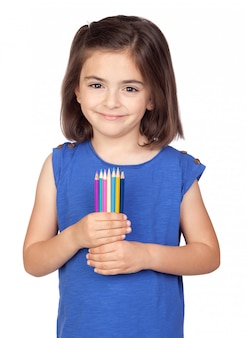 Brunette little girl with colored pencil isolated on a over white background