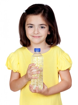 Brunette little girl with a water bottle isolated on a over white background