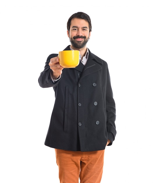 Brunette man holding a cup of coffee