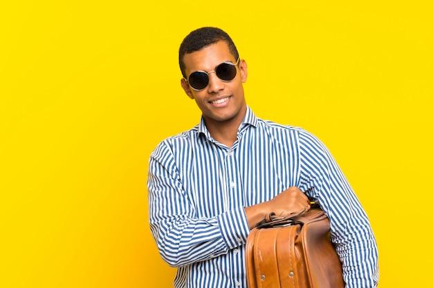 Brunette man holding a vintage briefcase