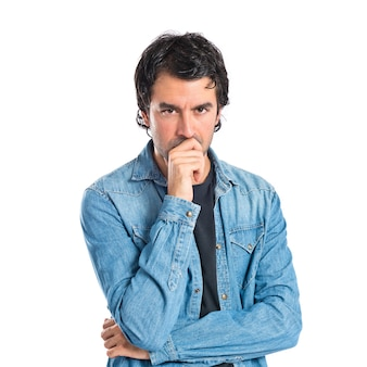 Brunette man thinking over isolated white background