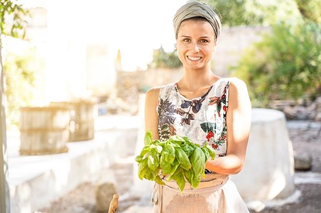Brunette mediterranean woman smiles cooking outdoors