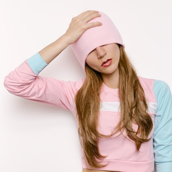 Brunette model. autumn -spring outfit feshion.vanilla style hipster trend girl swag beanie hat. pink vibration