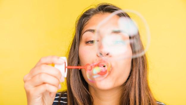 Brunette model blowing bubbles