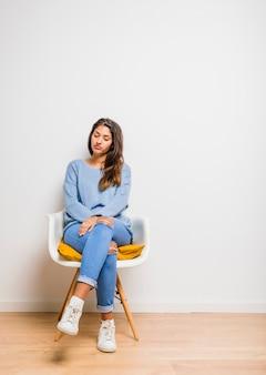 Brunette model bored sitting