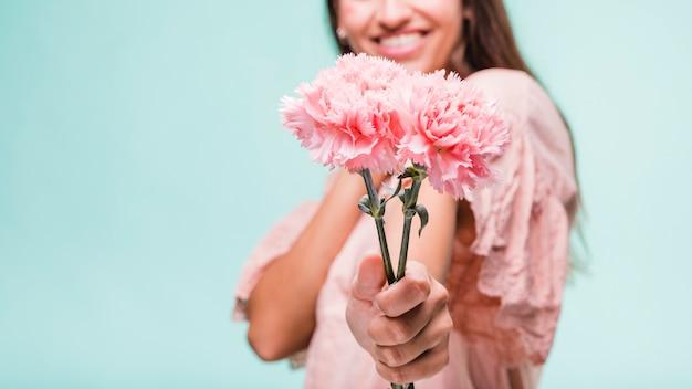 Brunette model posing with carnation