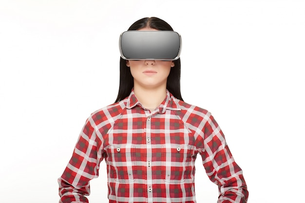 Brunette wearing in modern headset of virtual reality.