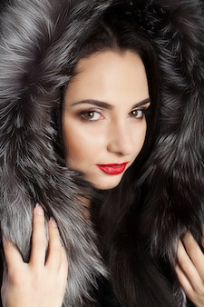Brunette with long beautiful hair, dressed in a coat