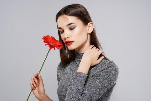Brunette with red flower glamor romance glamor