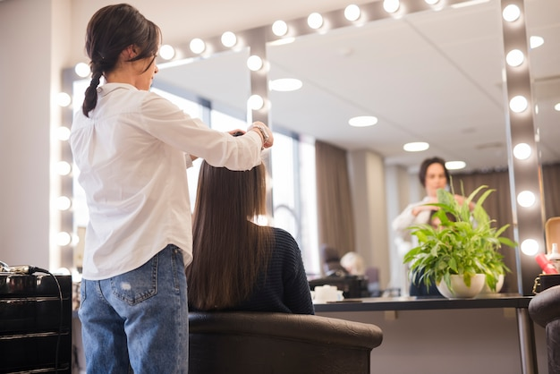 Brunette woman getting her hair done