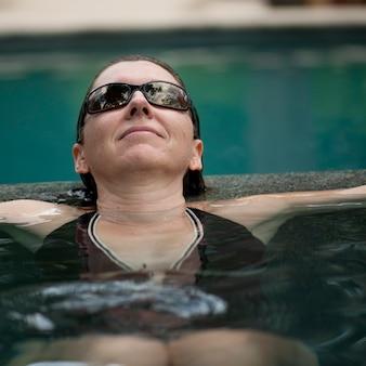 Brunette woman in a pool in costa rica