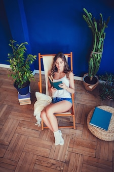Brunette woman reading the book.