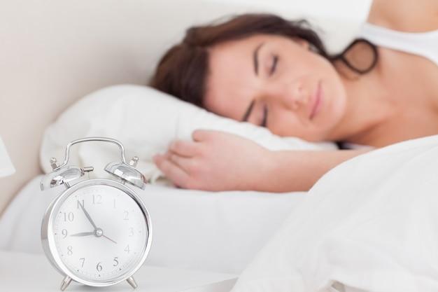 Brunette woman sleeping in the morning