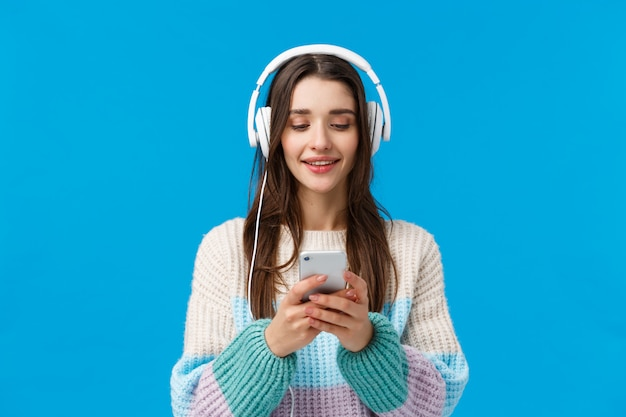 Brunette woman with earphones and mobile phone