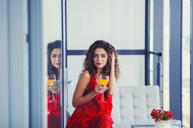 Brunette woman with juice