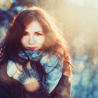 Brunette woman with scarf on a cold day