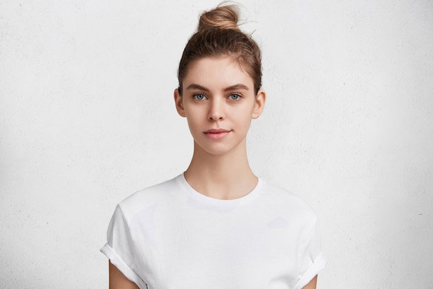 Brunette young woman in white t-shirt