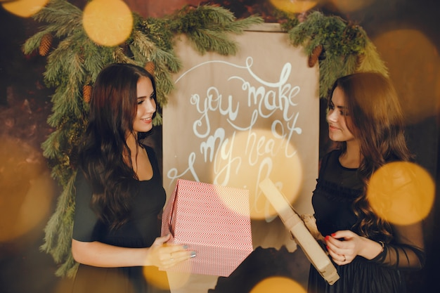 Brunettes in a christmas room