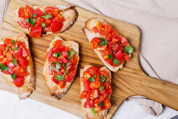 Bruschetta on a chopping board