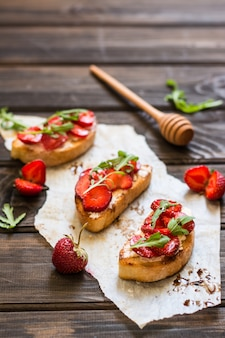 Bruschetta, cream cheese, strawberry, arugula, balsamic vinegar.