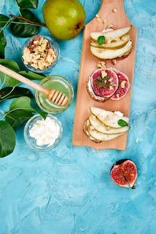 Bruschetta and crostini with pear, ricotta cheese, honey, figs