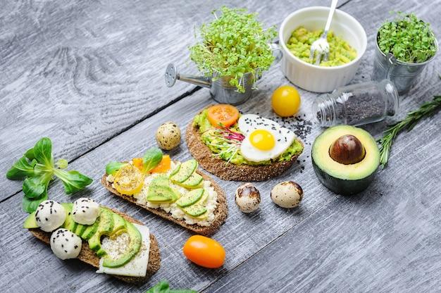 Bruschetta with avocado microgrin, quail eggs and adyghe cheese and mozzarella