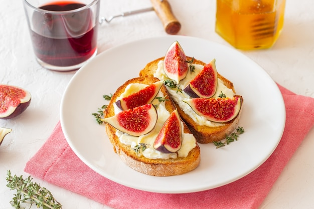 Bruschetta with figs, honey and cheese. healthy eating. vegetarian food.