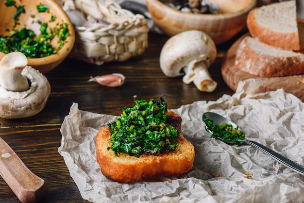 Bruschetta with fresh italian herbs mix
