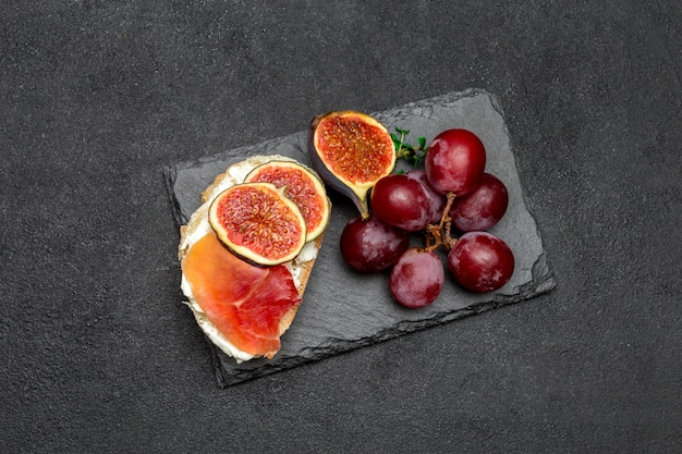 Bruschetta with ham, blue ceese and fresh figs